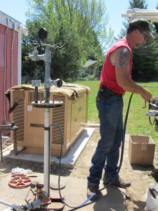 Finalizing electrical at the wellhead.